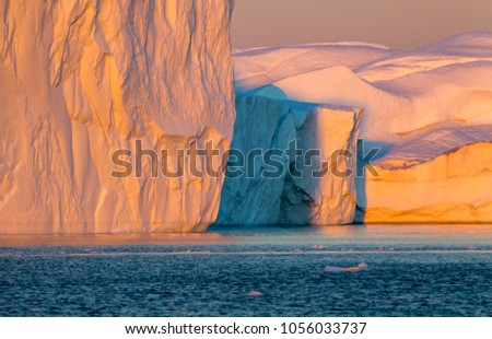 Nature and landscapes of Polar regions of the Earth. Travel on the scientific vessel among ices. Studying of a phenomenon of global warming. Ices and icebergs of unusual forms and colors. #1056033737