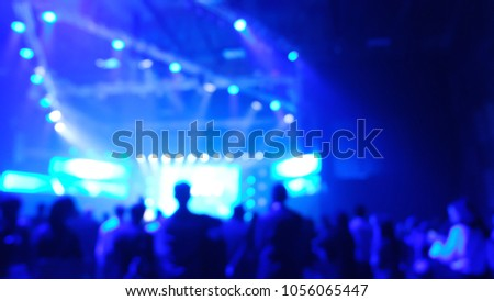 blurry background nightlife concert production light people in nightclub bokeh effect #1056065447