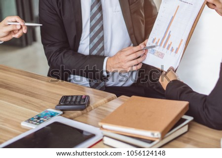 Young financial consultant presenting budget plan to client. #1056124148