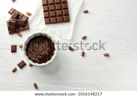 Flat lay composition with delicious chocolate on wooden background #1056148217