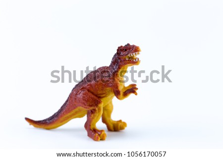 T rex funny mini macro dinosaur isolated in white background