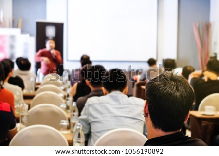 Audience listening speaker who standing in front of the room at the conference hall, Business and Entrepreneurship concept. #1056190892