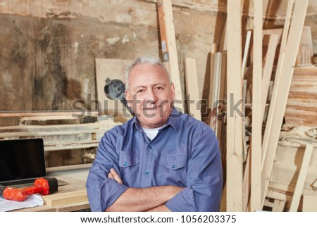 Portrait of content executive chief of carpentry shop #1056203375