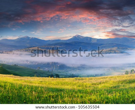 Summer landscape with a mountain village in the mist #105635504
