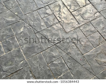 Grey stamped concrete background for texture design #1056384443