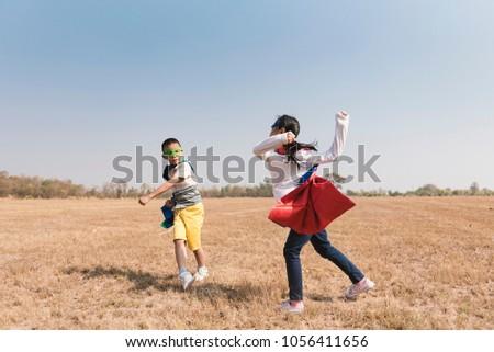 Superhero Kid Playing Fun Cheerful Concept.  #1056411656