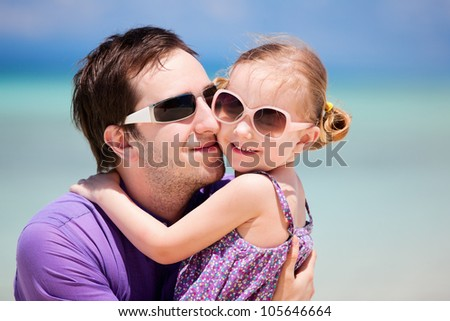Portrait of father and his little daughter on vacation #105646664