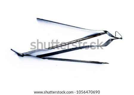 Two stainless steel tongs isolated on white. #1056470690
