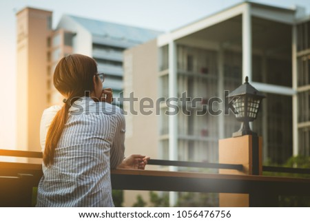 beautiful Asia business woman,student,teacher  sitting thinking to something  with worries and loneliness in the city . #1056476756
