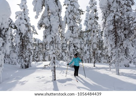 Woman cross country skiing in Lapland Finland #1056484439