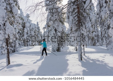 Woman cross country skiing in Lapland Finland #1056484445