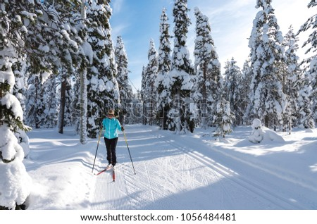 Woman cross country skiing in Lapland Finland #1056484481