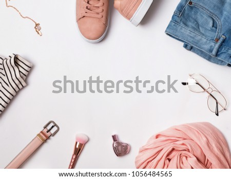 Stylish feminine outfit concept. Clothes and accessories on the white background #1056484565