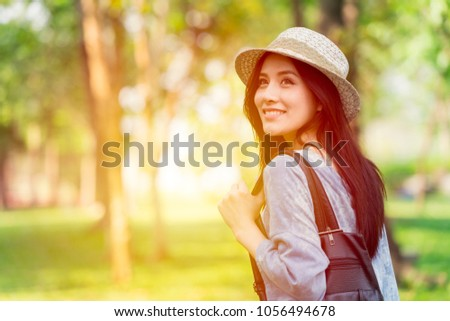Freedom and Finding Concept: Casual cute smart Asian women walking in the park in summer for holiday relax #1056494678