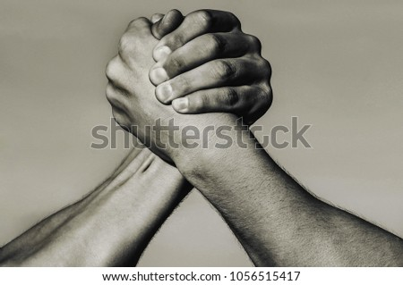 Hand, rivalry, vs, challenge, strength comparison. Two muscular hands. Rivalry concept. Man hand. Two men arm wrestling. Arms wrestling. Leadership concept, hands. Closep up, macro. Black and white.