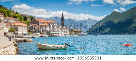 Scenic panorama view of the historic town of Perast located at world-famous Bay of Kotor on a beautiful sunny day with blue sky and clouds in summer, Montenegro, southern Europe #1056535301