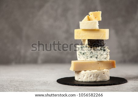 Different sorts of cheese Royalty-Free Stock Photo #1056582266