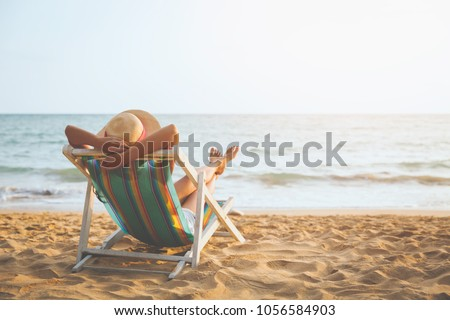 Summer beach vacation concept, Asia woman with hat relaxing and arm up on chair beach at Koh Mak, Trad, Thailand #1056584903