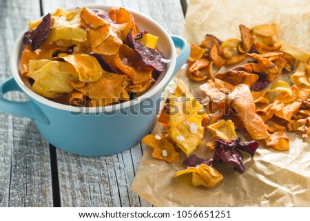 Mixed fried vegetable chips in pot. #1056651251