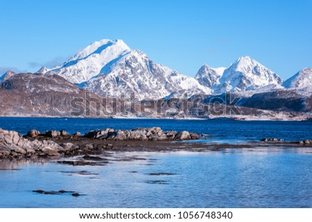 Scenery winter landscape in the Norway, wild northern nature. Rocky mountains with sea coast and serene blue sky, Lofoten Islands, Napp, Flakstad #1056748340