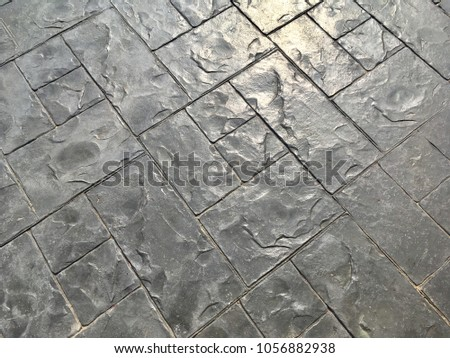 Grey stamped concrete background for texture design #1056882938