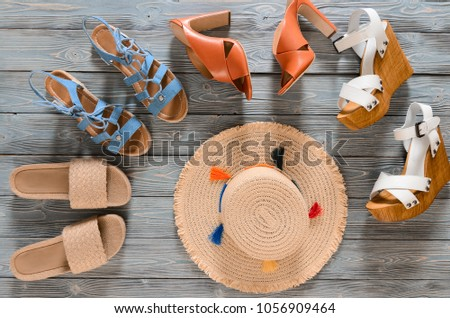 Set of womens shoes (wedges, heels and flat sandals) on grey wooden background. Spring summer collection. Flat lay. Template for online store, coupon, offer, promotion, discounts, gift card, deals #1056909464