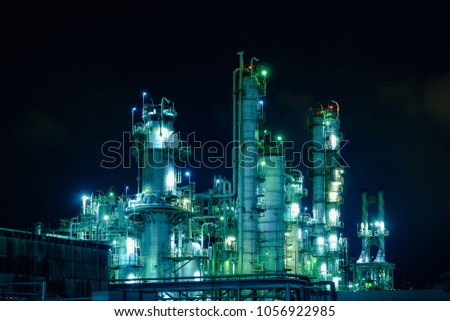Glitter lighting of industrial plant at night, Tower of oil and gas refinery plant, Manufacturing petrochemical plant #1056922985