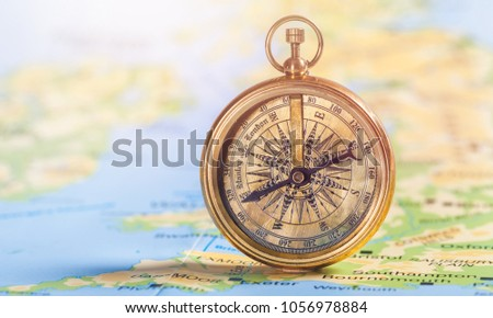 Compass on vintage map #1056978884
