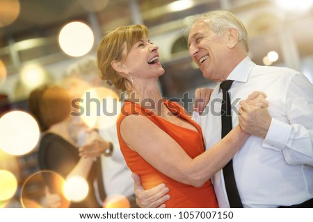 Romantic senior couple dancing together at dance hall Royalty-Free Stock Photo #1057007150