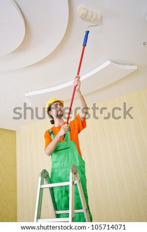 Painter worker during painting job #105714071