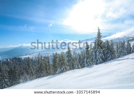 Ski slope at snowy resort on winter day #1057145894