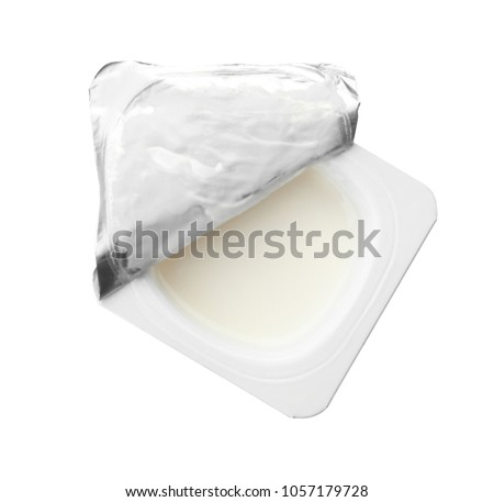 Plastic cup with yummy yogurt on white background #1057179728