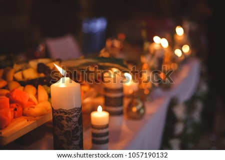 Candles on a family evening. Atmospheric evening. Table with candles.  #1057190132