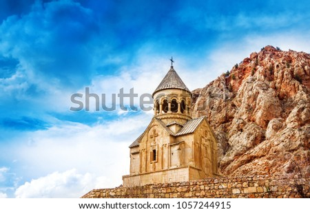 Scenic Noravank monastery in Armenia. against dramatic sky. Noravank monastery was founded in 1205. It`s located 122 km from Yerevan in  narrow gorge made by Darichay river nearby city of Yeghegnadzor #1057244915