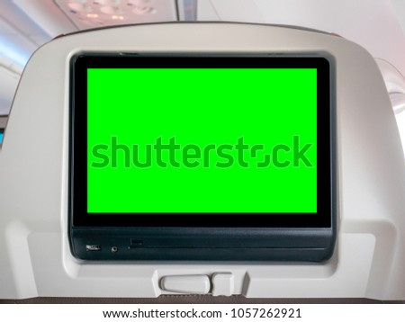 In-Flight Entertainment with Green Screen, Seatback Screen with Green Screen in Airplane #1057262921