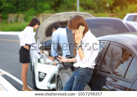woman calls on mobile phone for emmergency help after car accident, calling insurant with explain the location of accident #1057298357
