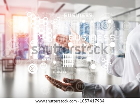 Closeup of business woman in shirt with business interface and media icons in her hands. Sunlight and office view on background. Mixed media. #1057417934
