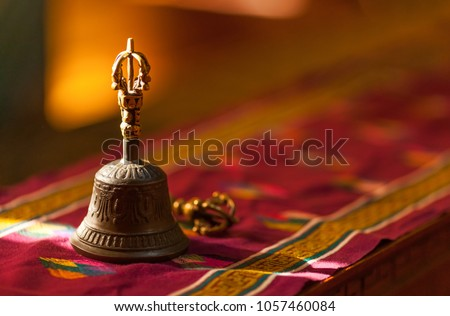Ritual hand bell in the Buddhist temple as the enlightenment symbol, has got to a light beam. #1057460084