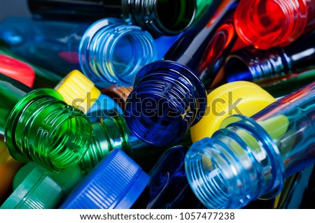 multicolored pet preforms for plastic bottles   Royalty-Free Stock Photo #1057477238
