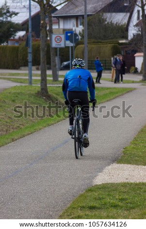 cyclist on a bikeway at easter springtime in south germany #1057634126