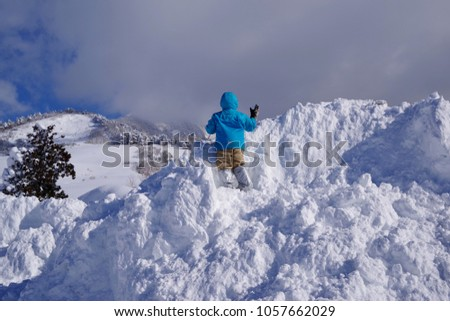 Children advance by sifting through the snow #1057662029