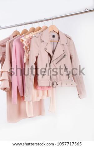 female colorful sundress, shirt , ,jacket on hanger    #1057717565