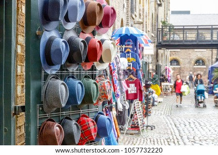 Assorted hats on display at Camden market in London #1057732220
