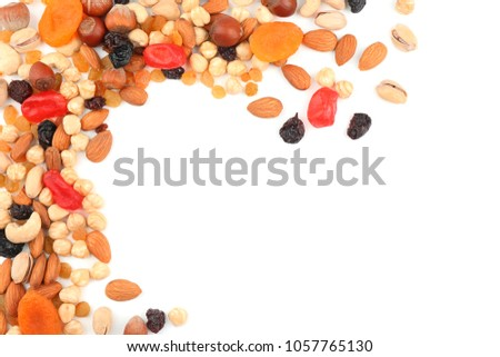 Different nuts, dried fruits and berries on white background, top view #1057765130