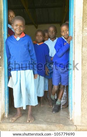 JANUARY 2005 - Children in blue uniforms at school near Tsavo National Park, Kenya, Africa #105779690