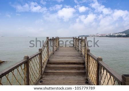 Seaside wooden plank #105779789