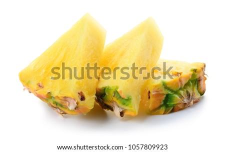 Pineapple slice isolated. Cut pineapple. Pineapple chunks on white. #1057809923