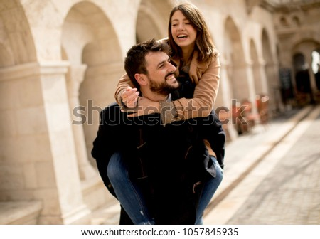 Walk of the pretty loving couple happily walking and having fun in Budapest, Hungary #1057845935