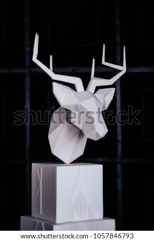An interesting creative cake.Christmas cake decorated with sweet figure of deer.interior design with deer #1057846793