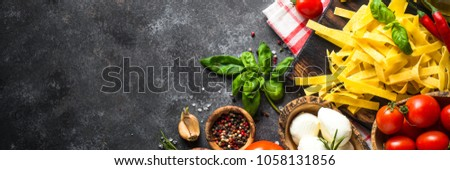Spices and herbs over black stone table.  #1058131856